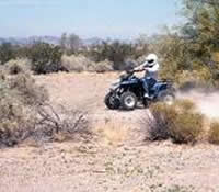 Four wheeler traveling through the desert