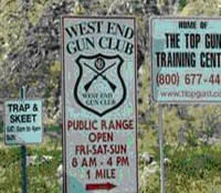 Two pictures,partially overlaid on one another. The background picture is a scenic view of the Arizona desert. A smaller foreground picture is that of signs providing shooting information.